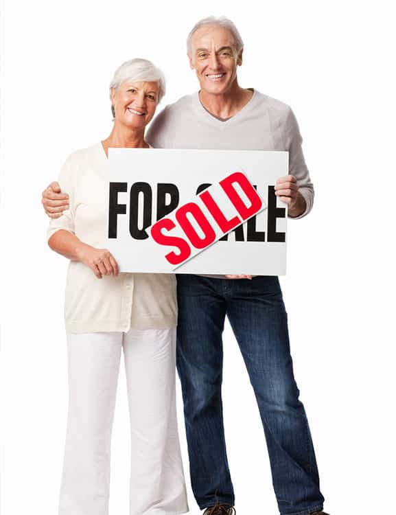 Male and female with a Just sold sign excited about their retirement in Florida