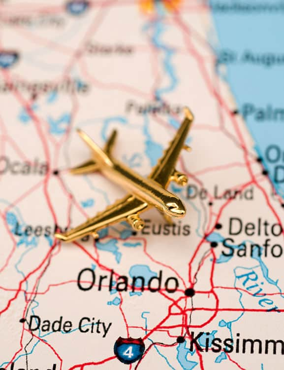 Airplane flying over a map of Orlando Florida