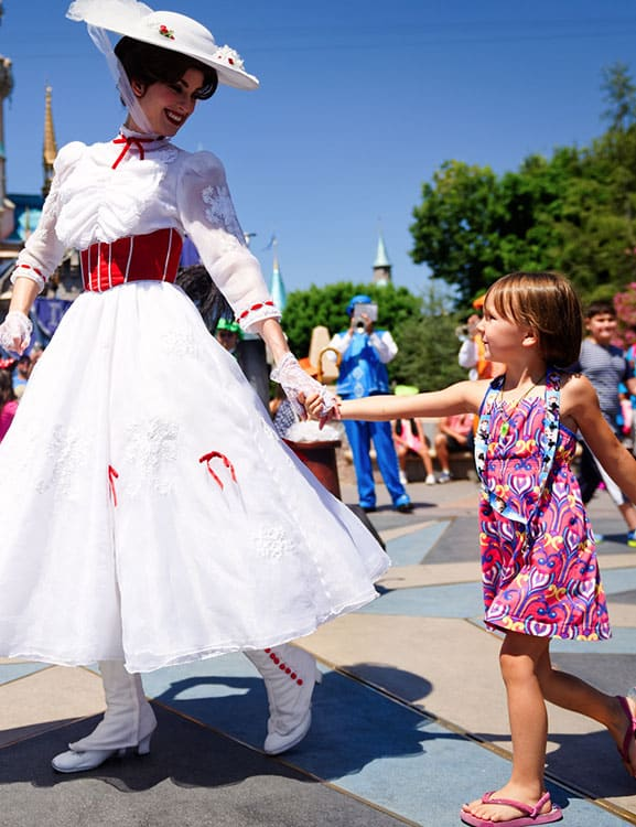 Mary Poppins holding hands with little girl in Disney's Magic Kingdom Orlando