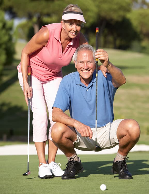 Retired couple playing golf