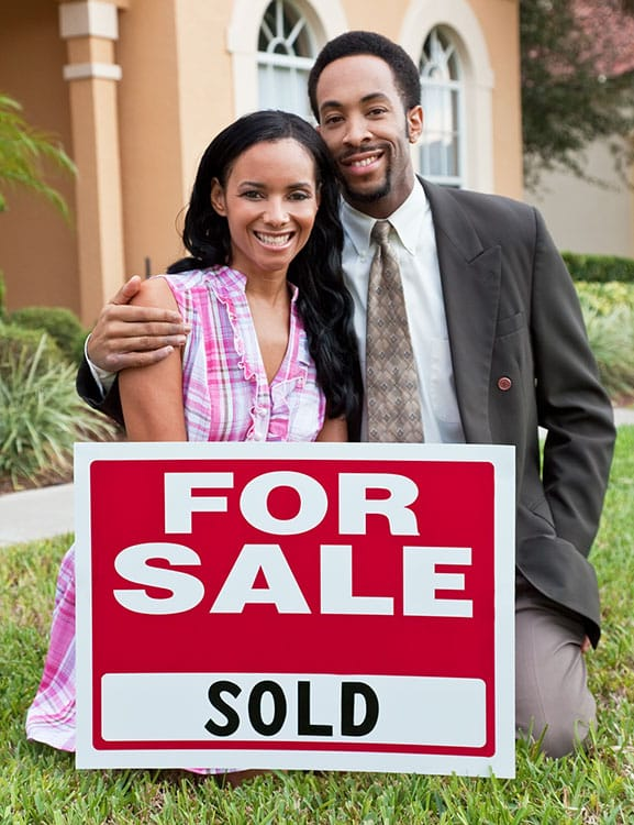 Couple celebrating after selling their home in Orlando