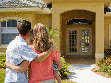 Couple outside a home for sale in Orlando